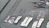 Flames destroy marina boathouses - (10/18)