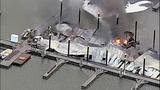 Flames destroy marina boathouses - (16/18)