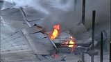 Flames destroy marina boathouses - (13/18)