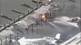 Flames destroy marina boathouses - (6/18)