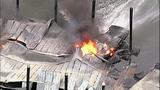 Flames destroy marina boathouses - (7/18)