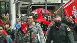 May Day protesters move through downtown - (17/25)