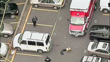Bullets, car in downtown shooting - (1/14)