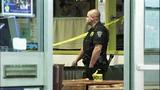 Bullet casings, evidence markers litter scene - (10/21)