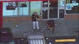 Bullet casings, evidence markers litter scene - (13/21)
