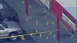 Bullet casings, evidence markers litter scene - (2/21)