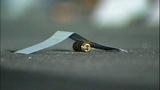 Bullet casings, evidence markers litter scene - (6/21)