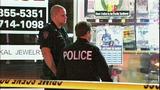 Bullet casings, evidence markers litter scene - (19/21)
