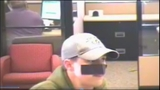 Bank robber uses tape as disguise - (7/7)