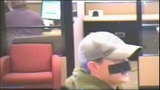 Bank robber uses tape as disguise - (3/7)