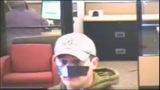 Bank robber uses tape as disguise - (1/7)