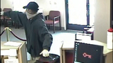 Bank robber caught on camera - (6/6)