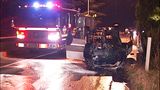 Flipped, burned-out car rests on Albro… - (1/11)
