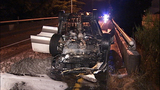 Flipped, burned-out car rests on Albro… - (6/11)