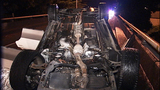 Flipped, burned-out car rests on Albro… - (9/11)