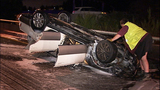Flipped, burned-out car rests on Albro… - (5/11)