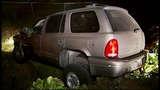 SUV takes out truck, fence in crash through yard - (5/16)
