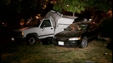 SUV takes out truck, fence in crash through yard - (10/16)