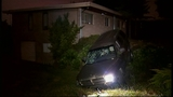 SUV takes out truck, fence in crash through yard - (4/16)