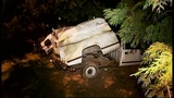 SUV takes out truck, fence in crash through yard - (16/16)