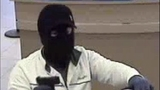 Sinister gunman sought in bank robberies - (3/4)