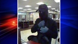 Sinister gunman sought in bank robberies - (1/4)
