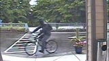 Sinister gunman sought in bank robberies - (4/4)