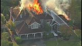Firefighters battle home engulfed in flames - (4/18)