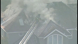 Firefighters battle home engulfed in flames - (15/18)