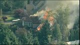Firefighters battle home engulfed in flames - (13/18)