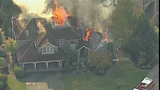 Firefighters battle home engulfed in flames - (5/18)