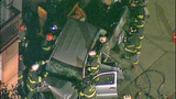 Rescuers cut top off destroyed car - (7/25)