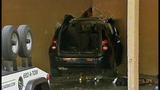 Car crashes into building's laundry room - (5/11)