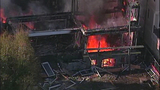 Raging flames devour adjacent homes - (21/21)