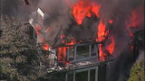 Raging flames devour adjacent homes - (15/21)