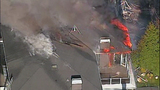 Raging flames devour adjacent homes - (1/21)