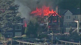 Raging flames devour adjacent homes - (4/21)