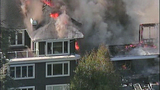 Raging flames devour adjacent homes - (2/21)