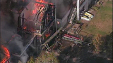 Raging flames devour adjacent homes - (7/21)