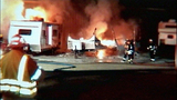 Fire rips through trailers, threatens building - (5/11)