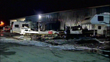 Fire rips through trailers, threatens building - (4/11)