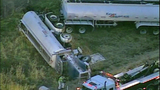 Tanker truck crashes off I-5, flips - (8/11)