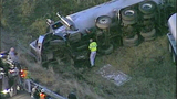 Tanker truck crashes off I-5, flips - (10/11)