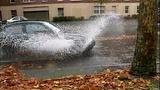 Cars, bikes splash through standing water - (3/8)