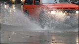 Cars, bikes splash through standing water - (4/8)