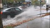 Cars, bikes splash through standing water - (2/8)