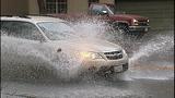 Cars, bikes splash through standing water - (8/8)