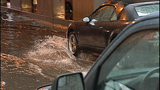 Cars, bikes splash through standing water - (7/8)
