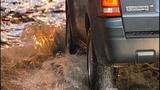 Cars, bikes splash through standing water - (1/8)