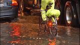 Cars, bikes splash through standing water - (5/8)